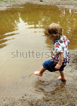 little-girl-stepping-into-a-mud-puddle-397439.jpg