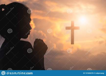 silhouette-young-woman-praying-cross-sunrise-christian-religion-concept-background-131650276